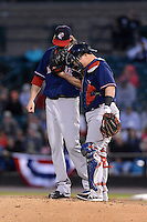 Pawtucket Red Sox pitcher Clay Buchholz (11) and catcher Christian Vasquez (17) meet on the mound during an International League playoff game against the Rochester Red Wings on September 5, 2013 at Frontier Field in Rochester, New York.  Pawtucket defeated Rochester 7-2.  (Mike Janes/Four Seam Images)
