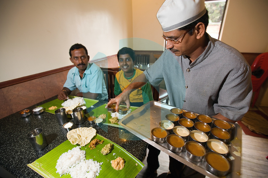January 25th 2008 _Trivandrum, India _Waiters in the Ariya Nivaas vegetarian restaurant wait to serve customers.  Ariya Nivaas serves dishes, which are traditional to the Southern Indian state of Karala. Photograph by Daniel J. Groshong/Tayo Photo Group