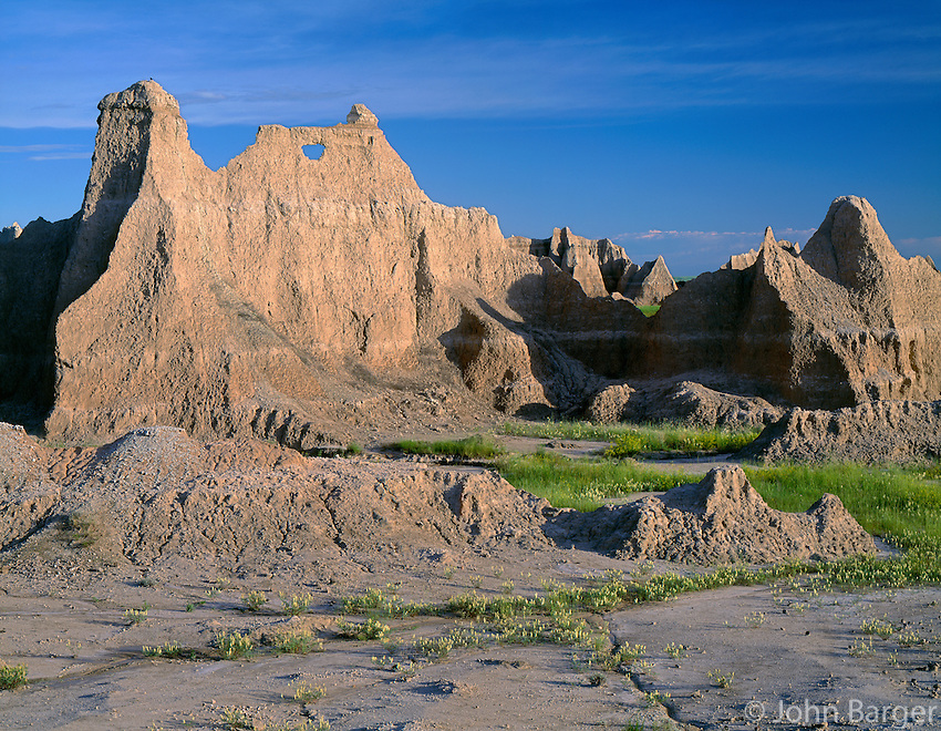 SDBD_008 - USA, South Dakota, Badlands National Park, Erosion of soft rock has formed a window in layered sediments, near Castle Trail, North Unit.