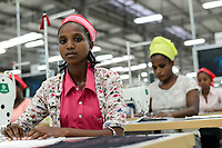 ETHIOPIA , Southern Nations, Hawassa or Awasa, Hawassa Industrial Park, chinese-built for the ethiopian government to attract foreign investors with low rent and tax free to establish a textile industry and create thousands of new jobs, taiwanese company Everest Textile Co. Ltd.produces textiles from synthetic fabric for export, training department for new worker / AETHIOPIEN, Hawassa, Industriepark, gebaut durch chinesische Firmen fuer die ethiopische Regierung um die Hallen fuer Textilbetriebe von Investoren zu vermieten, taiwanesische Firma Everest Textile Co. Ltd. produziert Textilien aus synthetischen Stoffen fuer den Export, Ausbildungsabteilung, Anlernen von neuen Arbeitskraeften, links Menalech Zeneb (19)