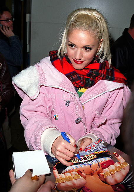 "*EXCLUSIVE*..No Doubt singer Gwen Stefani signing autographs as she leaves MTV Studios in New York after making an appearance on ""Total Request Live."" December 11, 2001. Please byline: Alecsey Boldeskul/NY Photo Press.   ..*PAY-PER-USE*      ....NY Photo Press:  ..phone (646) 267-6913;   ..e-mail: info@nyphotopress.com"