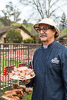 Frank Ostini, owner and chef of Buellton, CA restaurant Hitching Post II, with a plate of pork chops at the culmination of the Alisal BBQ Bootcamp. Participants try out their spice blends and cook their own BBQ, aided by the instructors. The Alisal Guest Ranch and Resort, Solvang, California.