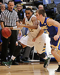 SIOUX FALLS, SD - MARCH 10:  Kory Brown #22 of North Dakota State drives past Mason Wedel #4 of UMKC during their quarterfinal game at the 2013 Summit League Basketball Championships. (Photo by Dick Carlson/Inertia)