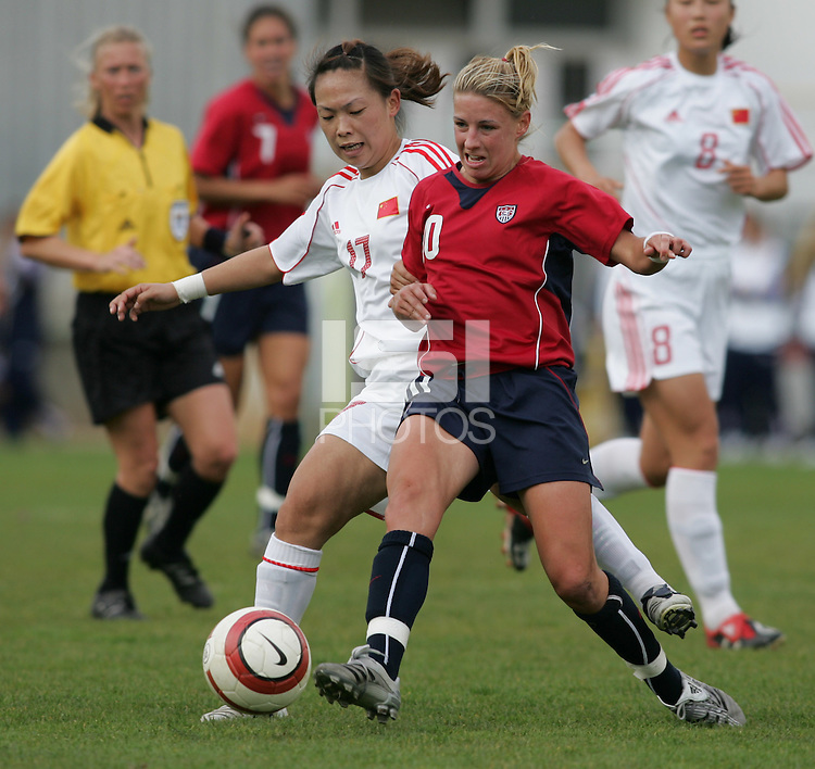 MAR 9, 2006: Faro, Portugal:  USWNT midifielder (10) Aly Wagner passes the ball away from China midfielder (17) Lina Pan at the Algarve Cup in Faro, Portugal. Mandatory Credit: Photo By Brad Smith-International Sports Images. (c) Copyright 2006 Brad Smith