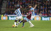 West Ham United's Michail Antonio gets in between Huddersfield Town's Terence Kongolo and Philip Billing<br /> <br /> Photographer Rob Newell/CameraSport<br /> <br /> The Premier League - Huddersfield Town v West Ham United - Saturday 10th November 2018 - John Smith's Stadium - Huddersfield<br /> <br /> World Copyright © 2018 CameraSport. All rights reserved. 43 Linden Ave. Countesthorpe. Leicester. England. LE8 5PG - Tel: +44 (0) 116 277 4147 - admin@camerasport.com - www.camerasport.com