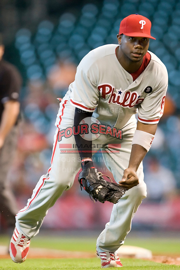 Philadelphia Phillies first baseman Ryan Howard #6 charges and fields a bunt during the Major League Baseball game against the Houston Astros at Minute Maid Park in Houston, Texas on September 14, 2011. Philadelphia defeated Houston 1-0 to clinch a playoff berth.  (Andrew Woolley/Four Seam Images)