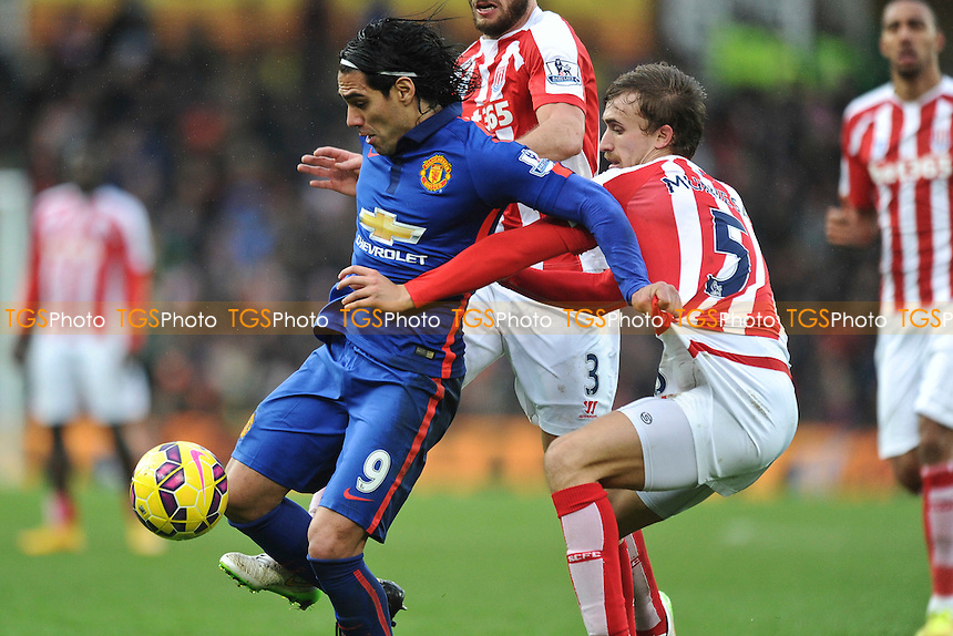 Radamel Falcao Garcia of Manchester United tries to control the ball from Marc Muniesa of Stoke City - Stoke City vs Manchester United - Barclays Premier League Football at the Britannia Stadium, Stoke-on-Trent - 01/01/15 - MANDATORY CREDIT: Greig Bertram/TGSPHOTO - Self billing applies where appropriate - contact@tgsphoto.co.uk - NO UNPAID USE