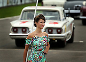10th September 2017, Goodwood Estate, Chichester, England; Goodwood Revival Race Meeting; A Grid Girl makes her way off the track for race start