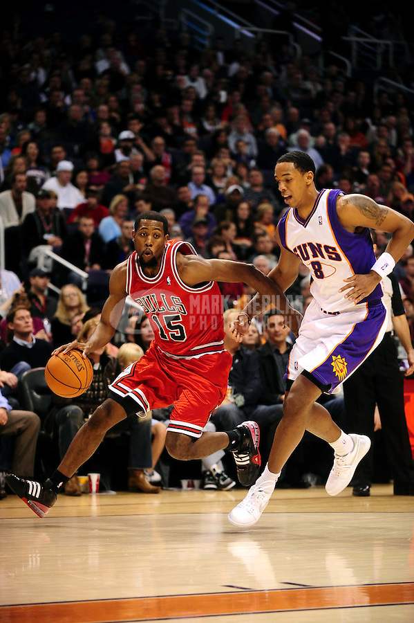 Jan. 22, 2010; Phoenix, AZ, USA; Chicago Bulls guard (15) John Salmons drives to the basket past Phoenix Suns center (8) Channing Frye at the US Airways Center. Chicago defeated Phoenix 115-104. Mandatory Credit: Mark J. Rebilas-