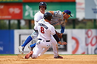 Hartford Yard Goats third baseman Josh Fuentes (13) dives in between Matt Oberste (5) and David Thompson (8) after chasing Oberste back to second base in a run down, as Thompson advanced to second, during a game against the Binghamton Rumble Ponies on July 9, 2017 at NYSEG Stadium in Binghamton, New York.  Oberste was called out on the play.  Hartford defeated Binghamton 7-3.  (Mike Janes/Four Seam Images)