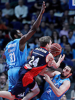 Asefa Estudiantes' Lamont Barnes (l) and German Gabriel (r) and Caja Laboral Baskonia's Brad Oleson during Liga Endesa ACB match.January 6,2012. (ALTERPHOTOS/Acero) /NortePhoto