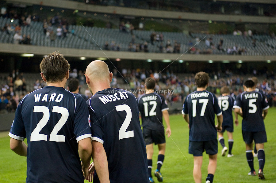 MELBOURNE, AUSTRALIA - MARCH 31, 2010: Melbourne Victory team members walk off the field after winning their game 1-0 at the AFC Champions League Group E match between the Melbourne Victory and KAWASAKI FRONTALE at Etihad Stadium on March 31, 2010 in Melbourne, Australia. Photo Sydney Low www.syd-low.com