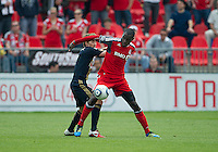 Philadelphia Union midfielder Brian Carroll #7 and Toronto FC midfielder Tony Tchani #22 in action during an MLS game between the Philadelphia Union and the Toronto FC at BMO Field in Toronto on May 28, 2011..The Philadelphia Union won 6-2..