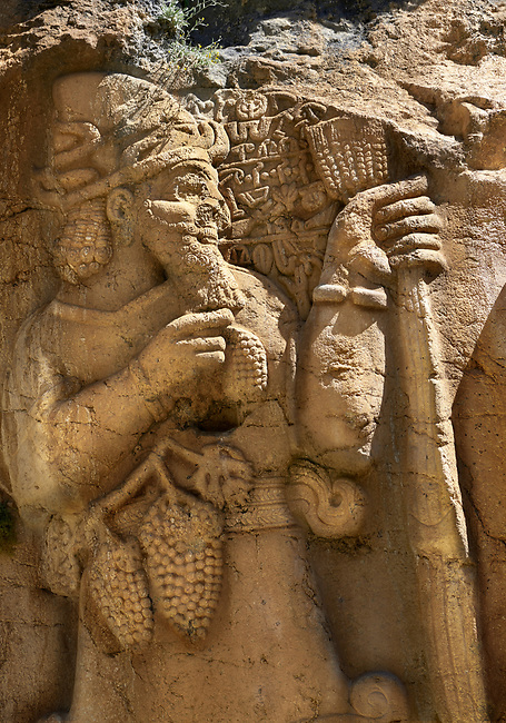 Close up picture of Tarhundas the God of Thunder talking to king Warpalawas. Ivriz Hittite rock relief sculpture monument dedicated to King Warpalawas. Ivriz, Turkey