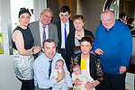 Sean and Mairead Curran, Knocknagree who celebrated the christening of their twins Ríonn and Aoibheann in the Killarney Oaks hotel on Saturday, back row: cait Murphy, Humphrey Curran, Brendan Curran, Mary Murphy and Fr Martin Sheehan