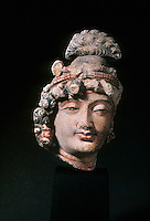 """India: Head of Bodhisattva. Stucco, with color, 10 3/4 in., Afghanistan.  """"Compassion and sympathy for human frailties"""" .  PAL.  INDIAN SCULPTURE. Gupta Age--4th-5th Century A.D."""
