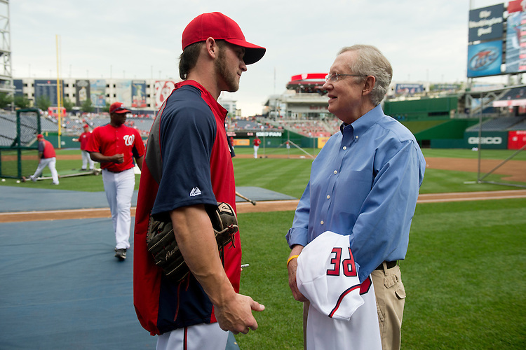 UNITED STATES - MAY 4: Senate Majority Leader Harry Reid, D-Nev., speaks with Washington Nationals outfielder Bryce Harper, a native of Nevada, at Nationals Park in Washington before the game against Philadelphia on Friday, May 4, 2012. (Photo By Bill Clark/CQ Roll Call)