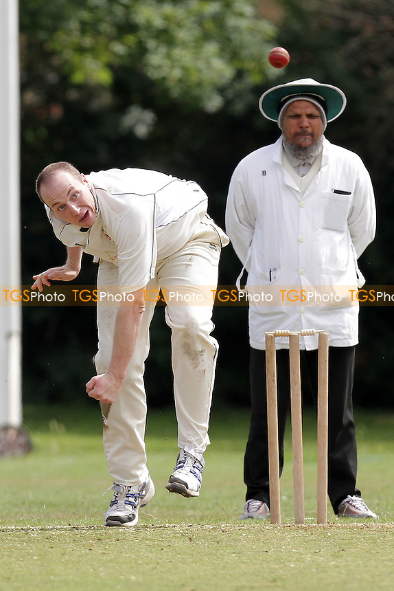 P Crane in bowling action for Hornchurch Athletic - Hornchurch Athletic CC (fielding) vs Barking CC - Essex Cricket League - 09/07/11 - MANDATORY CREDIT: Gavin Ellis/TGSPHOTO - Self billing applies where appropriate - Tel: 0845 094 6026 - contact@tgsphoto.co.uk