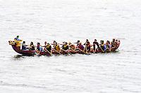 Asian Dragon racing boat team practicing on Lake Phalen. Dragon Festival Lake Phalen Park St Paul Minnesota USA