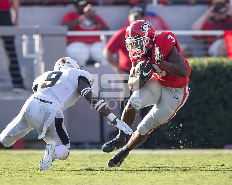 ATHENS, GA - SEPTEMBER 7: Zamir White #3 tries to elude tackle by Murray State's Dior Johnson #9 during a game between Murray State Racers and University of Georgia Bulldogs at Sanford Stadium on September 7, 2019 in Athens, Georgia.