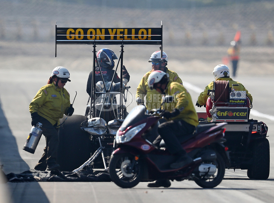 Nov 11, 2018; Pomona, CA, USA; NHRA safety safari rescue crews tend to top fuel driver Steve Torrence during the Auto Club Finals at Auto Club Raceway. Mandatory Credit: Mark J. Rebilas-USA TODAY Sports