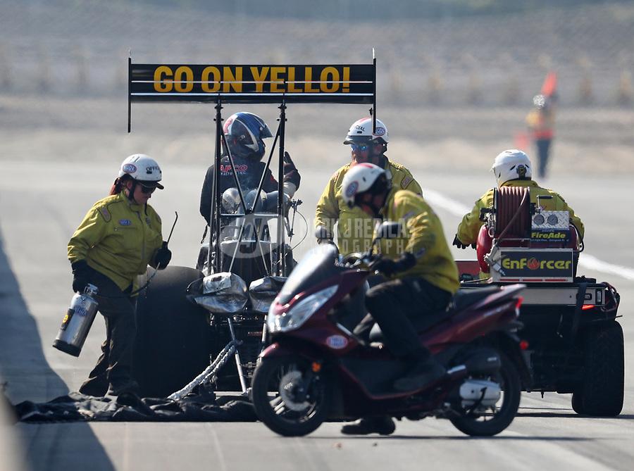 Nov 11, 2018; Pomona, CA, USA; NHRA safety safari rescue crews tend to top fuel driver Steve Torrence during the Auto Club Finals at Auto Club Raceway. Mandatory Credit: Mark J. Rebilas-USA TODAY Sports