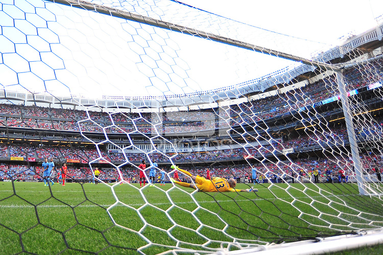 BRONX, NY - Wednesday July 30, 2014: The top two finishers from last year's Barclays Premier League square off in iconic Yankee Stadium as part of the 2014 Guinness International Champions Cup.  After two goals a piece in regulation, Liverpool wins on penalty kicks.