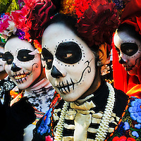 Young girls, representing a Mexican cultural icon called La Catrina, take a part in celebrations of the Day of the Dead (Día de Muertos) in Mexico City, Mexico, 29 October 2016.