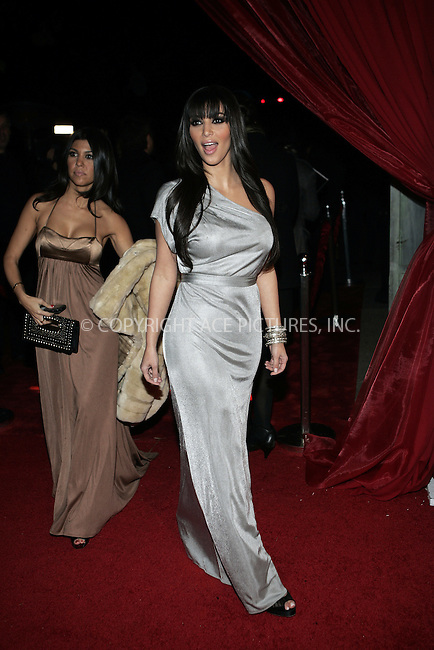 WWW.ACEPIXS.COM . . . . . ....December 18 2008, LA....L-R) Courtney Kardashian and Kim Kardashian arriving at Flaunt Magazine's 10th anniversary and annual holiday toy drive at The Wayne Kao Mansion on December 18, 2008 in Los Angeles, California.....Please byline: JOE WEST- ACEPIXS.COM.. . . . . . ..Ace Pictures, Inc:  ..(646) 769 0430..e-mail: info@acepixs.com..web: http://www.acepixs.com