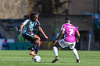 Marcus Bean of Wycombe Wanderers takes on Andy Yiadom of Barnet during the Sky Bet League 2 match between Wycombe Wanderers and Barnet at Adams Park, High Wycombe, England on 16 April 2016. Photo by Andy Rowland.