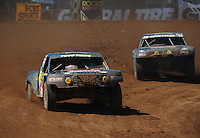 Apr 16, 2011; Surprise, AZ USA; LOORRS driver Kyle Leduc (99) leads Todd Leduc (4) during round 3 at Speedworld Off Road Park. Mandatory Credit: Mark J. Rebilas-.