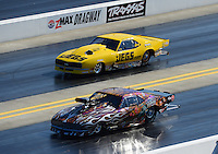 Apr. 14, 2012; Concord, NC, USA: NHRA pro mod driver Mike Knowles (near lane) races alongside Troy Coughlin during qualifying for the Four Wide Nationals at zMax Dragway. Mandatory Credit: Mark J. Rebilas-
