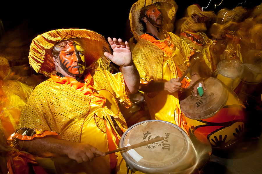 A drum battery performs during the parade of Llamadas during Carnaval in Montevideo, Uruguay.