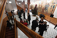 NWA Democrat-Gazette/J.T. WAMPLER Guests visit Monday Dec. 2, 2019 during a Christmas Celebration at the historic Washington County Courthouse in Fayetteville. Guests were encouraged to bring unwrapped gifts for donation to Arkansas Children's Northwest.