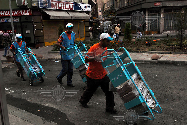 Newspaper deliverers on their early morning rounds in central Istanbul.