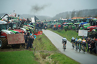 riders racing through a hague of protesting farmers<br /> <br /> 77th Gent-Wevelgem 2015