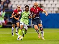 REIMS, FRANCE - JUNE 08: Ngozi Ebere #4 fights for the ball with Maria Thorisdottir #3 during a game between Norway and Nigeria at Stade Auguste-Delaune on June 8, 2019 in Reims, France.