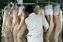 June 23, 2010- Tokyo, Japan - A worker at Orient Industry's factory in Tokyo, Japan, takes away Love Doll body to be processed on June 23, 2010. Orient Industry is a 33-year-old company which is number one in Japan for producing over 1,000 Love Dolls annually, ranging in price from ¥90,000 to ¥700,000.