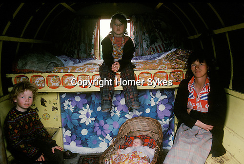 Gypsy family southern Ireland interior  traditional decorated horse drawn caravan. Eire.