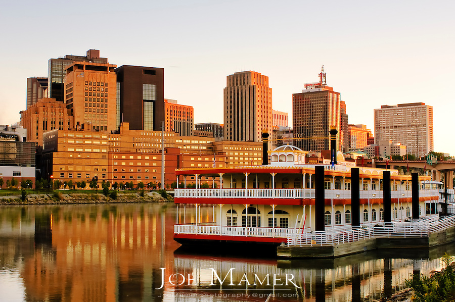 St. Paul, Minnesota across the Mississippi River at dawn. Paddle boat in foreground.