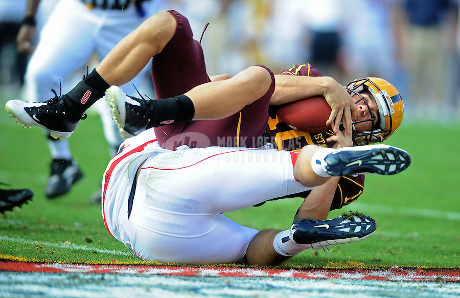 Nov. 28, 2009; Tempe, AZ, USA; Arizona State Sun Devils quarterback (10) Samson Szakacsy is sacked in the second quarter against the Arizona Wildcats at Sun Devil Stadium. Mandatory Credit: Mark J. Rebilas-