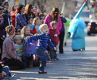 NWA Democrat-Gazette/ANDY SHUPE<br /> Malaki McGarrah, 3, of Rogers dances Saturday, Feb. 6, 2016, during the 15th Fat Saturday Parade of Fools organized by Fayetteville Mardi Gras in downtown Fayetteville. The 25th annual Fat Tuesday on Dickson Street is planned for 8 p.m. Tuesday beginning at Farrell's Lounge. Visit nwadg.com/photos to see more photographs from the parade.