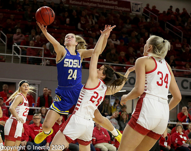 VERMILLION, SD - JANUARY 19: Tagyn Larson #24 of the South Dakota State Jackrabbits takes the ball to the basket against Ciara Duffy #24 of the South Dakota Coyotes at the Sanford Coyote Center on January 19, 2020 in Vermillion, South Dakota. (Photo by Dave Eggen/Inertia)