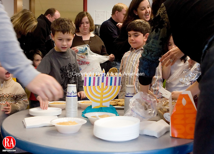 SOUTHBURY, CT- 17 DEC 06- 121706JT02- <br /> Jacob Wetchler, 5, and Jacob Finkel-Hozer, 6, dig in to treats during a celebration of Chanukah at the B'nai Israel Religious School on Sunday at the Walzer Family Jewish Community Center Campus in Southbury.<br /> Josalee Thrift Republican-American