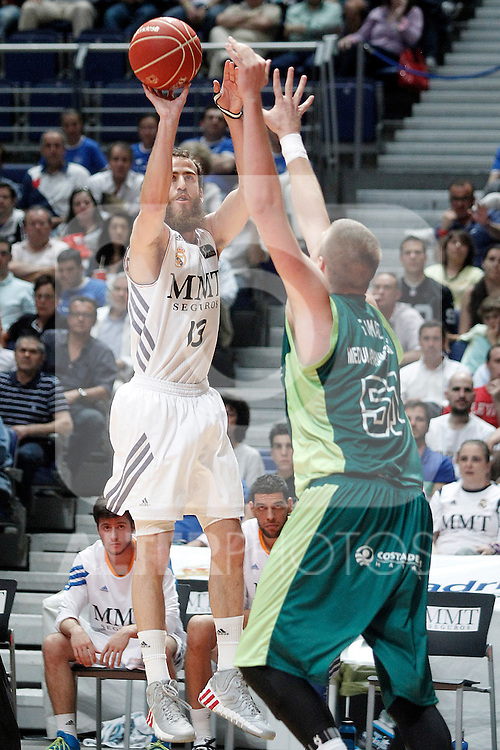 Real Madrid's Sergio Rodriguez (l) and Unicaja's Vladimir Stimac during Liga Endesa ACB Semifinal match.June 6,2014. (ALTERPHOTOS/Acero)