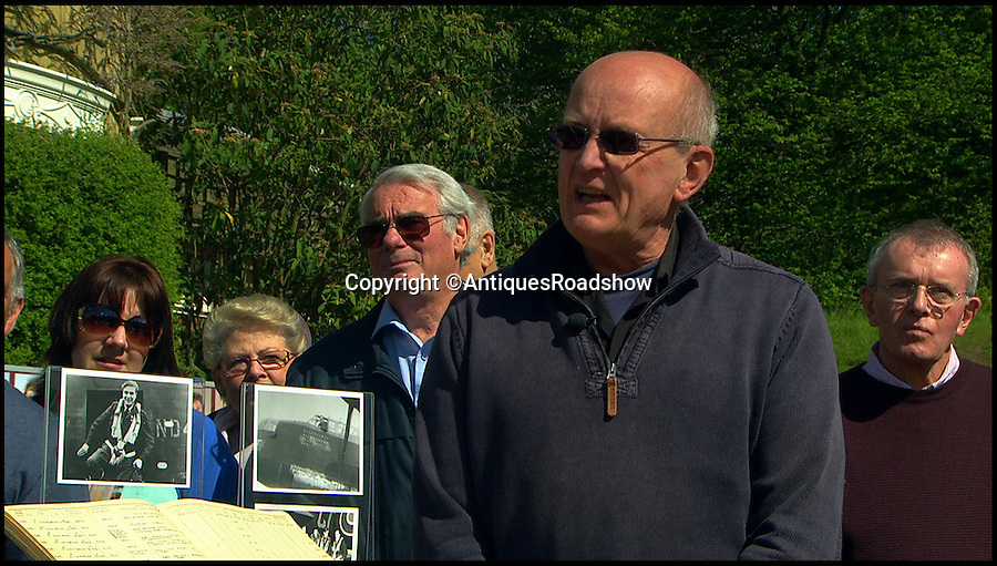 BNPS.co.uk (01202 558833)<br /> Pic: AntiquesRoadshow/BNPS<br /> <br /> ***Must use full byline***<br /> <br /> Philip Douetil at the Antiques Roadshow <br /> <br /> The remarkable story of how a free-falling RAF pilot was saved when the beam of a searchlight enabled him to locate his parachute has emerged for the first time.<br /> <br /> Squadron Leader Barry Douetil plunged out of his blazing Lancaster bomber at 20,000ft and was horrified when he realised his parachute wasn't strapped to his body.<br /> <br /> It was only when he hurtled for a split second through the bright beam of the German searchlight that he spotted it was on the end of a strap 10ft above him.<br /> <br /> While still falling through the air in the dark, the 21-year-old managed to rein the cord in until he was able to put the parachute on and pull the release cord in the nick of time.<br /> <br /> He landed heavily 10 seconds later in a frozen field but escaped the 1944 near-death experience with just a dislocated shoulder.