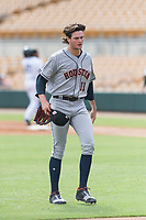 Scottsdale Scorpions starting pitcher Forrest Whitley (11), of the Houston Astros organization, walks off the field between innings of an Arizona Fall League game against the Glendale Desert Dogs at Camelback Ranch on October 16, 2018 in Glendale, Arizona. Scottsdale defeated Glendale 6-1. (Zachary Lucy/Four Seam Images)