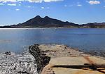 Coastline at Isleta de Moro village, Cabo de Gata natural park, Nijar, Almeria, Spain Los Frailes volcanoes