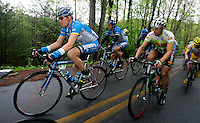 Tom Danielson (left), of the Discovery Channel Pro Cycling Team, rides in the peloton during Stage 5 of the Ford Tour de Georgia. Danielson won the 94.5-mile (152.1-km) stage from Blairsville to the top of Brasstown Bald, the highest point in the state.<br />