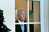 United States Vice President Joe Biden looks on during a bilateral meeting between President Obama and President Petro Poroshenko of Ukraine in the Oval Office of the White House September 18, 2014 in Washington, DC. <br /> Credit: Olivier Douliery / Pool via CNP